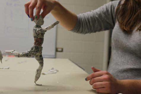 human figure sculture made with paper mache