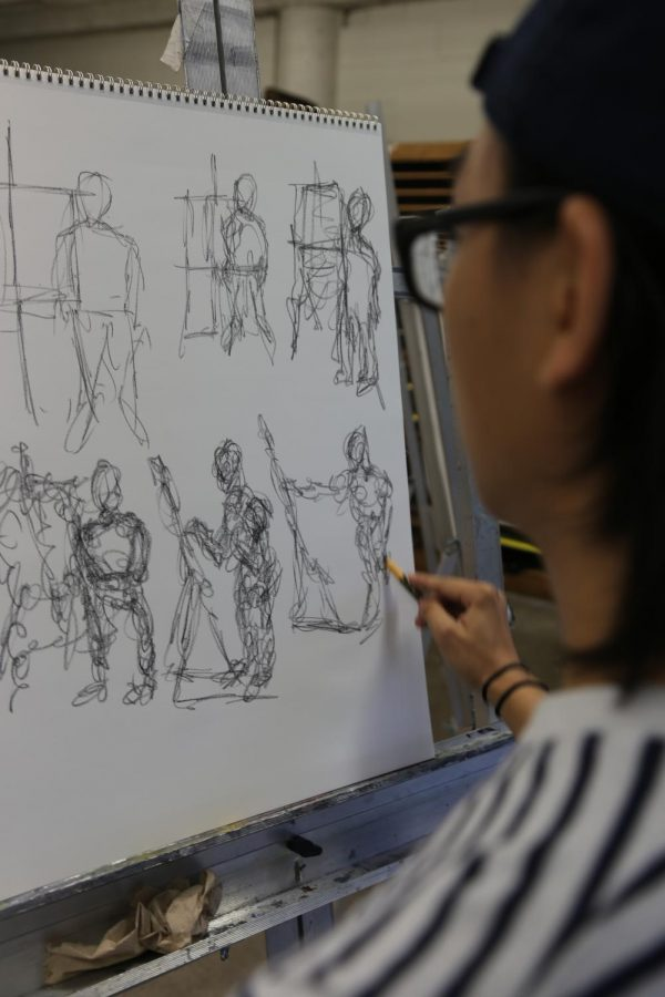 Sketching the human form in art class at Century College