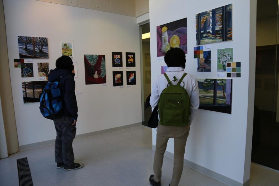 Students reviewing art in The Niche Gallery, Century College West Campus