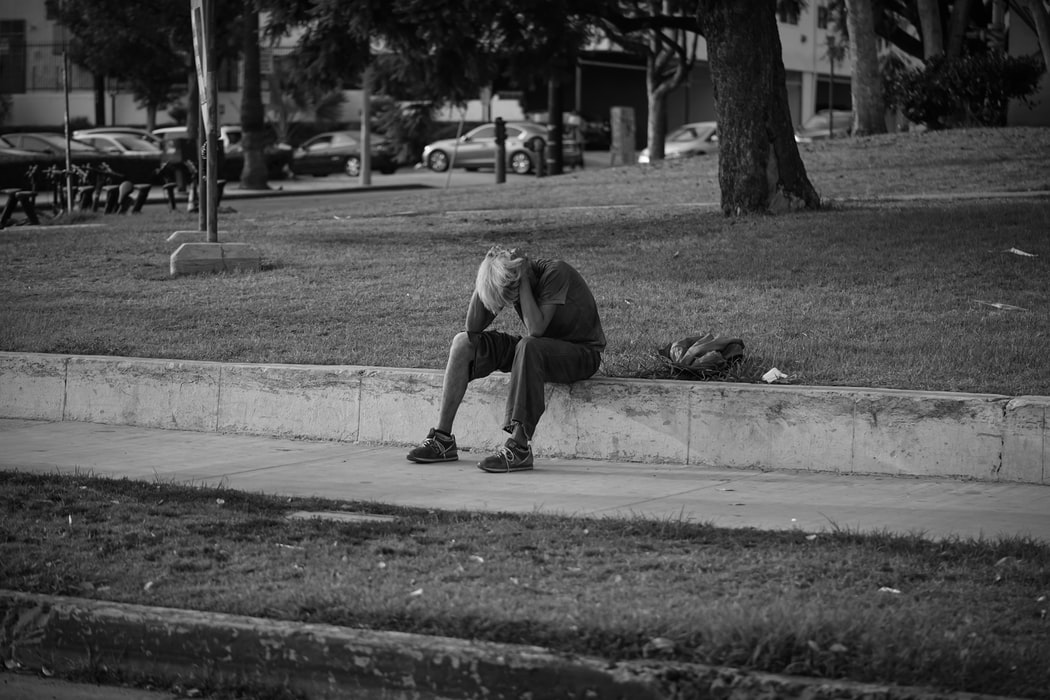 Person sitting on a curb
