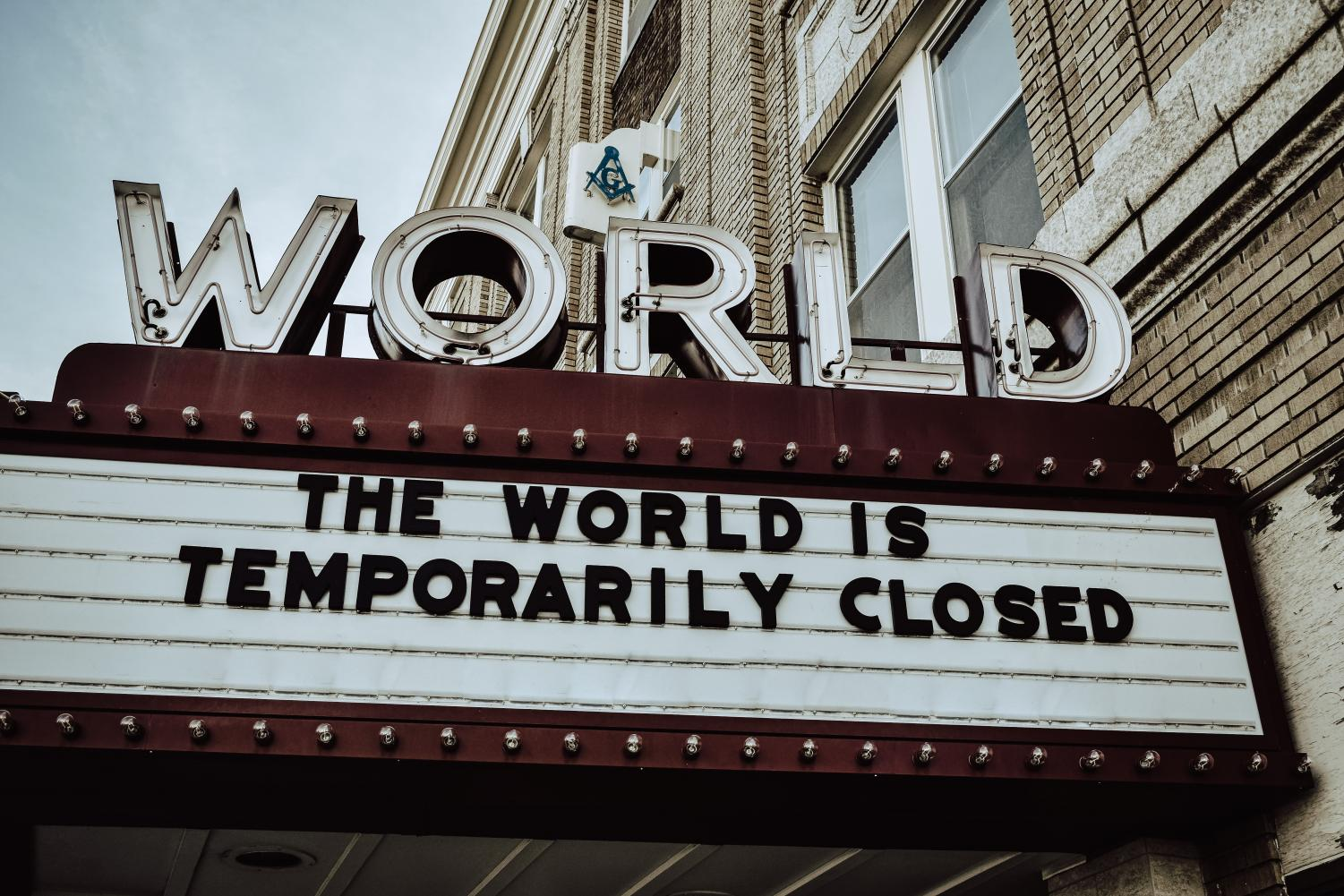 "World Theater sign reads ""The World is Temporarily Closed"""