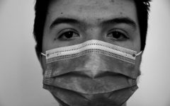Grayscale photo of person wearing mask