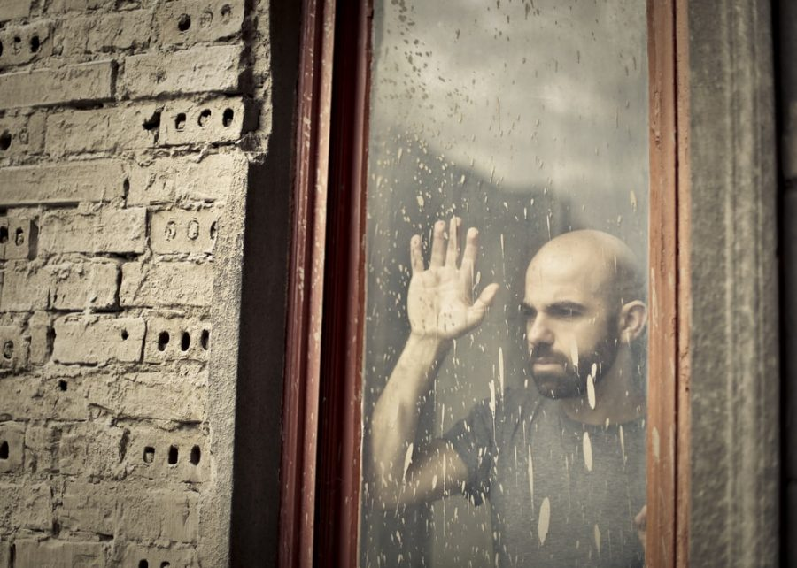 Guy looking aimlessly out of a window