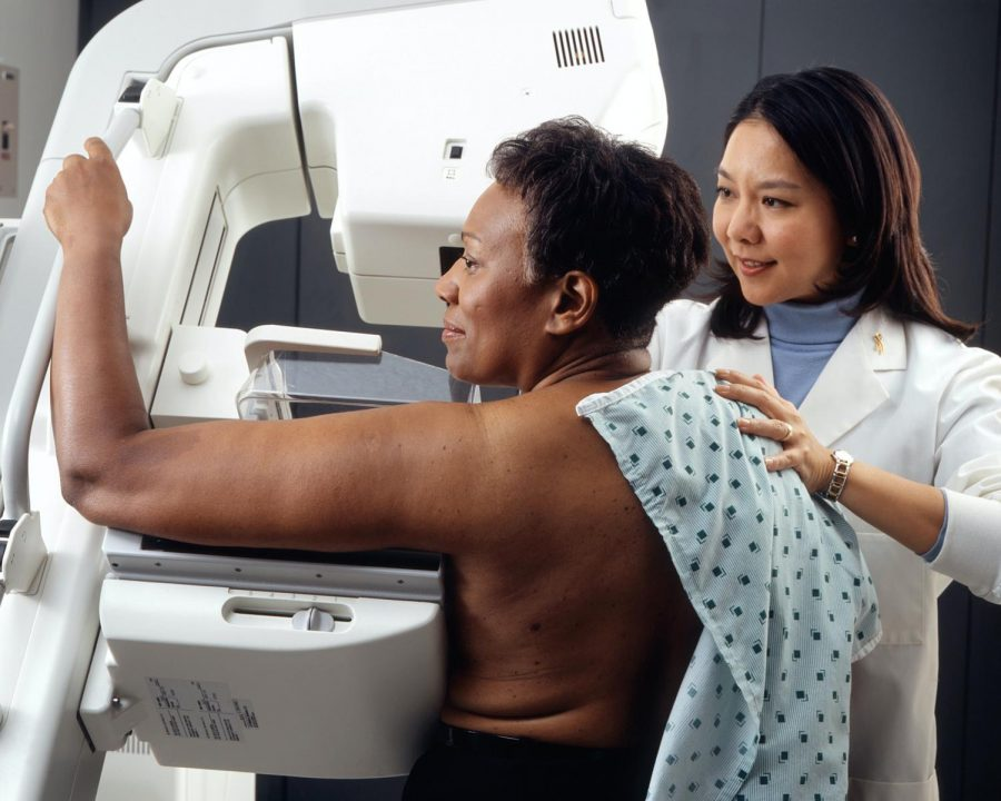 African American woman is screened for breast cancer.