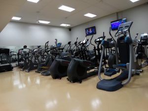 Image of the elliptical and bike machines in the Century College weight room.