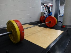 Full weight bar ready for power lifting.