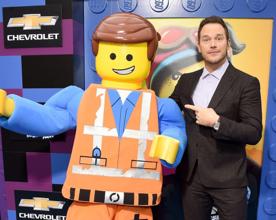 Chris Pratt featured with Emmet mascot, who is the main character from The Lego Movie series.
